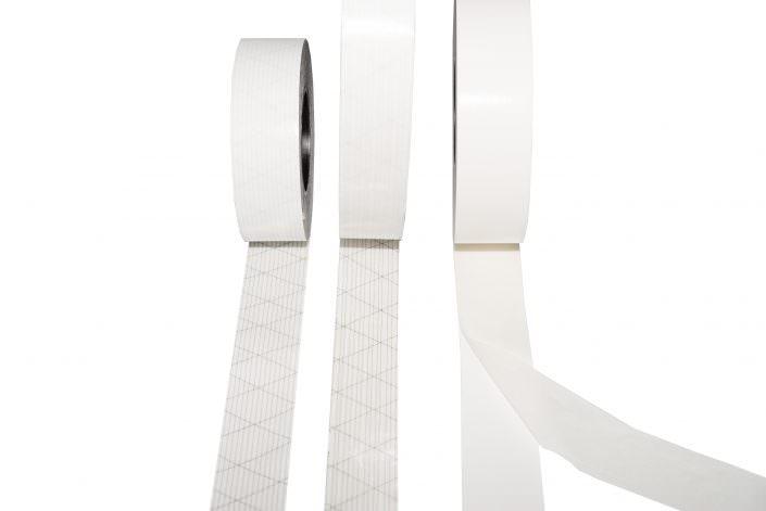 Doppelseitig klebende Bänder mit Gewebe- & Gelegeträger